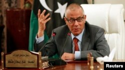 FILIE - Libya's Prime Minister Ali Zeidan speaks during a joint news conference with Oil Minister Abdelbari al-Arusi at the Prime Minister's Office in Tripoli, July 31, 2013.
