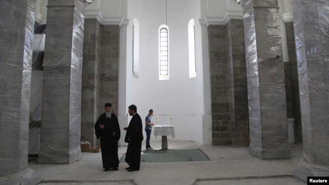 FILE - Ethnics Serbs attend an Orthodox Easter mass at Saint Sava church in Mitrovica, Kosovo, May 5, 2013.