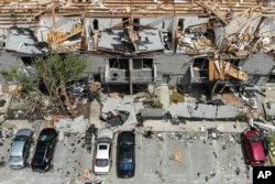 Debris is strewn about the front sidewalks of destroyed homes at the River's Edge apartment complex the day after a tornado struck the city, in Dayton, Ohio, May 28, 2019.