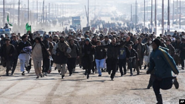 Afghan demonstrators run as they shout anti-US slogans during a protest against Koran desecration in Kabul, February 23, 2012.