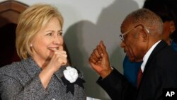 Democratic presidential candidate Hillary Clinton greets and gives a thumbs-up to Fred Gray, Rosa Parks' former attorney, before speaking at the Dexter Avenue King Memorial Baptist Church, Dec. 1, 2015, in Montgomery, Alabama.
