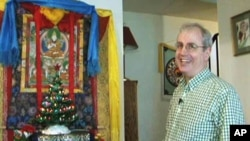 Wilson Hurley has put up a Christmas tree in his house in front of an image of Buddha
