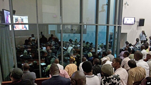 People watch a live broadcast of the verdict in the Netherlands-based trial of former Liberian president Charles Taylor, at the Special Court for Sierra Leone, in Freetown, Sierra Leone, April 26, 2012.