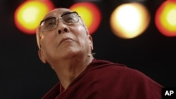 """Tibet's exiled spiritual leader the Dalai Lama attends a conference called """"Living Together with Responsibility and Cooperation"""" in Sao Paulo September 17, 2011."""