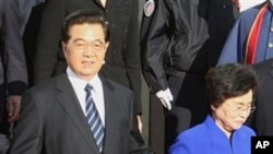 Chinese President Hu Jintao and his wife leave the Hotel Negresco in Nice, southern France, 06 Nov 2010