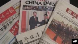 """中国报纸在头版显著位置报道""""胡奥会"""""""