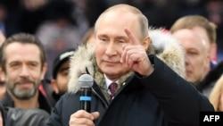 Le président Vladimir Poutine, en campagne pour la prochaine présidentielle, au stade Luzhniki, Moscou, 3 mars 2018.
