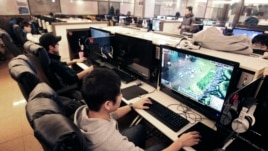 Shin Minchul, bottom, a 21-year-old college student, plays online computer games at an Internet cafe in Seoul, South Korea, Wednesday, Dec. 11, 2013.
