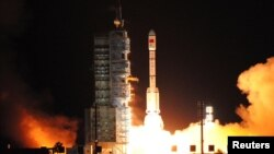 FILE - China's second experimental space laboratory lifts off from the launch pad in Jiuquan, Gansu province, China, Sept. 15, 2016.
