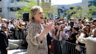 FILE - Democratic presidential candidate Hillary Clinton speaks to people in the overflow area during a campaign event at Los Angeles Southwest College in Los Angeles, April 16, 2016. Despite a formidable challenge from Senator Bernie Sanders, Clinton is likely to clinch the nomination June 7.