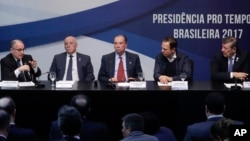 Foreign ministers of Mercosur, from left, Argentina's Jorge Faurie, Paraguay's Eladio Loizaga, Brazil's Aloysio Nunes, Sao Paulo Mayor's Joao Doria, and Uruguay's Foreign Minister Rodolfo Nin Novoa, give a statement to the media, in Sao Paulo, Brazil, Aug. 5, 2017. The South American trade bloc has decided to suspend Venezuela for failing to follow democratic norms.