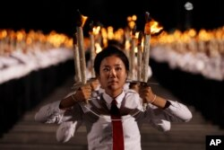 North Korean youths holding torches march during a torch light march at the Kim Il Sung Square in conjunction with the 70th anniversary of North Korea's founding day in Pyongyang, North Korea, Sept. 10, 2018.