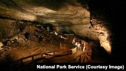 Visitors explore the cave