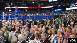 Delegates on the floor watching speakers at the Republican National Convention, Tampa, Florida, August 28, 2012. (J. Featherly/VOA)