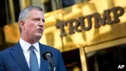 FILE - New York Mayor Bill de Blasio holds a news conference in front of Trump Tower following a meeting with President-elect Donald Trump, Nov. 16, 2016, in New York.