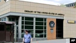 In this file photo, a Russian policeman stands in front of an entrance to the U.S. Embassy in downtown Moscow, Russia, on May 14, 2013.
