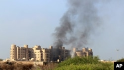 Smoke rises following an explosion that hit Hotel al-Qasr where Cabinet members and other government officials are staying, in the southern port city of Aden, Yemen, Oct. 6, 2015.