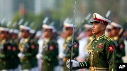 FILE - Myanmar soldiers parade during a ceremony to mark the 69th anniversary of Union Day in Naypyitaw, Myanmar. Kyaw Swa Naing and editor Kyaw Min Swe were arrested in June after a military officer filed a complaint against them.