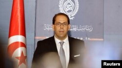 Tunisia's Prime Minister-designate Youssef Chahed speaks during a news conference in Tunis, August 3, 2016.