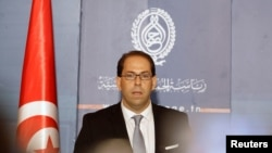 FILE - Tunisia's then-Prime Minister-designate Youssef Chahed speaks during a news conference in Tunis, Tunisia, Aug. 3, 2016.