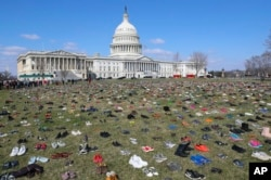 About 7,000 pairs of shoes, one for every child killed by gun violence since the Sandy Hook school shooting, were placed on the Capitol lawn by Avaaz, a U.S.-based civic organization, on Capitol Hill in Washington, March 13, 2018.