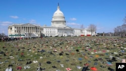 7000 pairs of shoes, one for every child killed by gun violence since the Sandy Hook school shooting, were placed on the Capitol lawn by Avaaz, a U.S.-based civic organization, on Capitol Hill in Washington, Tuesday, March 13, 2018.