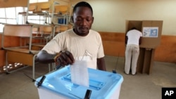 A man casts his ballot at a voting station in Kicolo, Luanda, Angola, August 31, 2012.