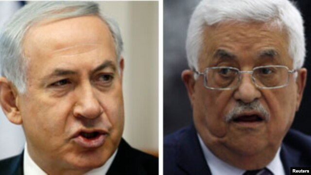 (L-R) Israeli Prime Minister Benjamin Netanyahu and Palestinian President Mahmoud Abbas.