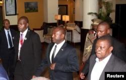 Burundi President Pierre Nkurunziza, center, is escorted on his way to the Julius Nyerere International Airport in Dar es Salaam, Tanzania, May 13, 2015.