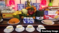 A traditional offering of food to ancestors on the eve of Tet in Vietnam.