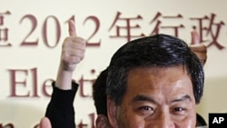 The next Hong Kong Chief Executive Leung Chun-ying celebrates as he attend a news conference at a vote counting station in Hong Kong, March 25, 2012.