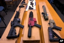 """FILE - This Nov. 27, 2019, file photo shows """"ghost guns"""" on display at the headquarters of the San Francisco Police Department in San Francisco."""