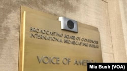 Signage is seen at the entrance to Voice of America headquarters in Washington. (Mia Bush/VOA)