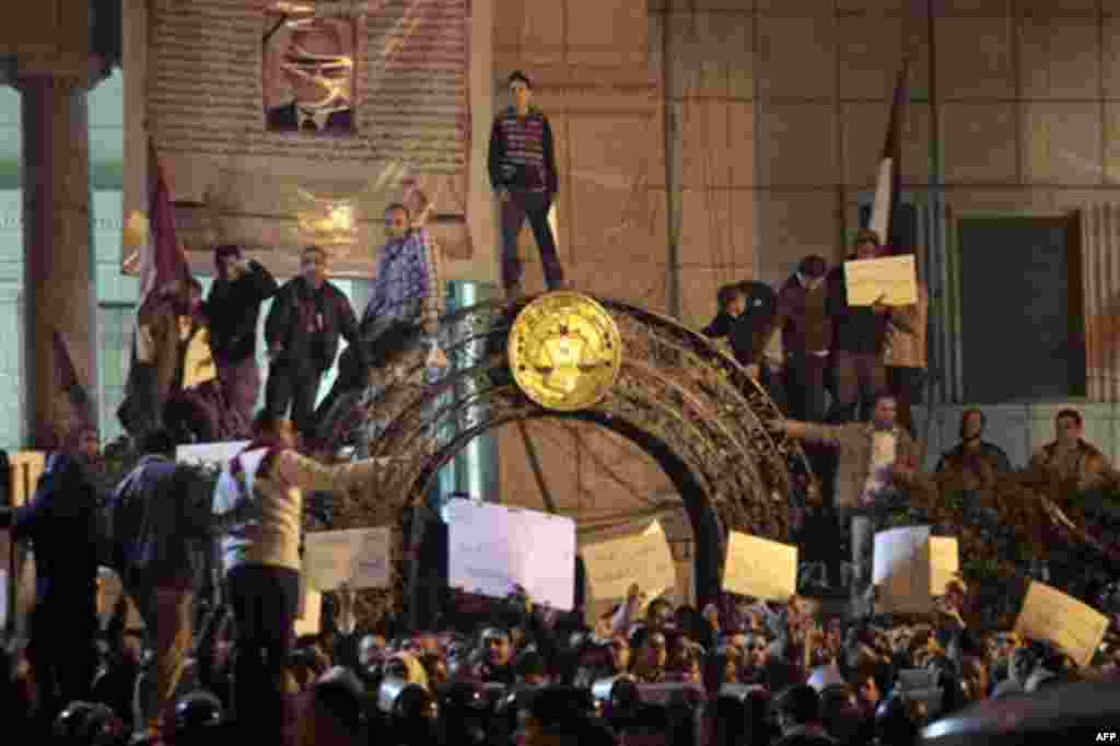 Egyptian anti-government activists chant slogans as they gather inside the Lawyers Syndicate in downtown Cairo, Egypt, Wednesday, Jan. 26, 2011. Egyptian anti-government activists clashed with police for a second day Wednesday in defiance of an official b