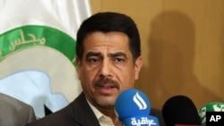 Falah al-Qaisi, anggota dewan provinsi Baghdad, berbicara pada media di Baghdad, Sabtu, 26 Juli 2014. Riyadh al-Adhadah, seorang dokter dan kepala Dewan Provinsi Baghdad, diciduk Jumat malam oleh kawanan bersenjata yang datang dengan 10 mobil SUV hitam.