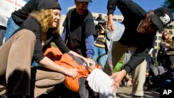 Protesters simulate the use of waterboarding on a volunteer at an anti-torture rally in front of the Justice Department in Washington, Nov. 5, 2007. (AP Photo/Manuel Balce Ceneta)