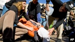 FILE - Protesters simulate the use of waterboarding on a volunteer at an anti-torture rally in front of the Justice Department in Washington, Nov. 5, 2007.