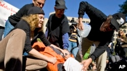 Protesters simulate the use of waterboarding on a volunteer at an anti-torture rally in front of the Justice Department in Washington, Nov. 5, 2007.