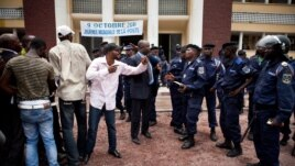 Diomi Ndongala (center, wearing suit) and other opposition activists are seen confronting policemen in Kinshasa in this October 13, 2011, file photo.