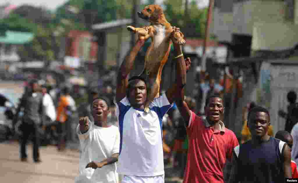 Des militants de l'opposition manifestent contre le président Joseph Kabila, à Kinshasa, en RDC, le 19 décembre 2016.