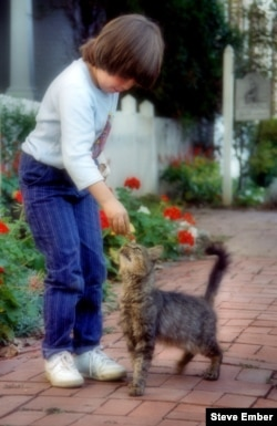 Liitle kitty in Burkittsville, Maryland with her human best friend