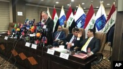 FILE - Kareem al-Tamimi, spokesman of Iraq's Independent High Electoral Commission announce the results of the country's Parliamentary elections early, May 19, 2018 in Baghdad.
