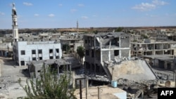 A picture taken on September 30, 2015 shows a general view of deserted streets and damaged buildings in the central Syrian town of Talbisseh in the Homs province.