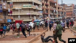 Polisi ya Uganda mu Ruhigi rw'abanse kuguma mu mihana yabo.