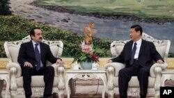 2012年3月31日中国北京: 中国国家副主席习近平(右)会见哈萨克斯坦总理马西莫夫