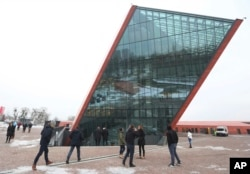 FILE - People visit the Museum of the Second World War, an ambitious new museum under creation for nine years which is almost completed, in Gdansk, Poland, Jan. 23, 2017.