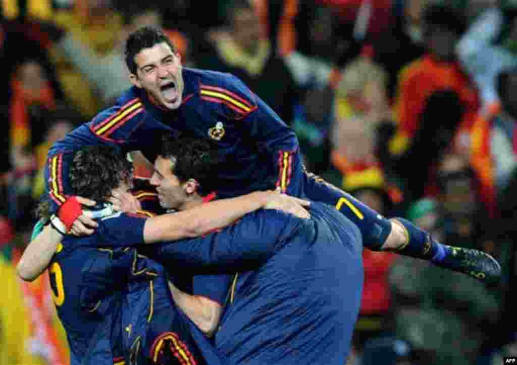 Spain's David Villa, top, celebrates with teammates at the end of the World Cup final soccer match between the Netherlands and Spain at Soccer City in Johannesburg, South Africa, Sunday, July 11, 2010. Spain won 1-0.(AP Photo/Daniel Ochoa de Olza)