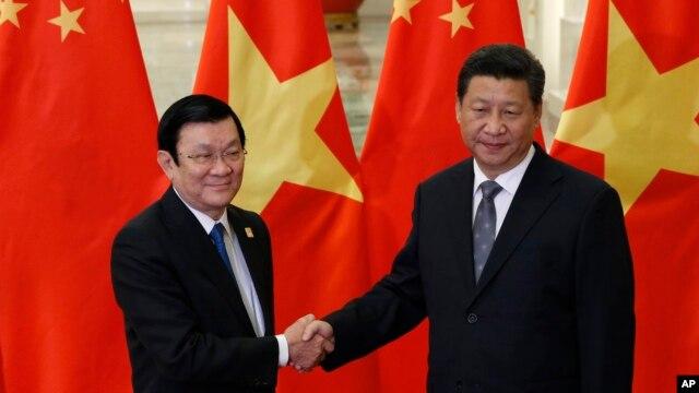 Ông Trương Tấn Sang trong một cuộc gặp với Chủ tịch Trung Quốc Tập Cận Bình ở Bắc Kinh hôm 10/11/2014. Cả hai nhà lãnh đạo Việt Nam cùng tới Mỹ để dự Hội nghị Thượng đỉnh của Liên Hiệp Quốc.