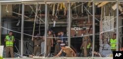 A Sri Lankan Police officer inspects a blast spot at the Shangri-la hotel in Colombo, Sri Lanka, April 21, 2019.