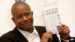"Paul Beatty, from the United States, wins the 2016 Man Booker Prize for fiction for his book ""The Sellout"" in London, Oct. 25, 2016."